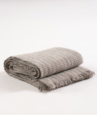 Organic wool blanket made by Teixidors in collaboration with John Pawson stone
