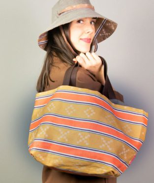 Reversible carrycot bag made with an old brown mattress fabric